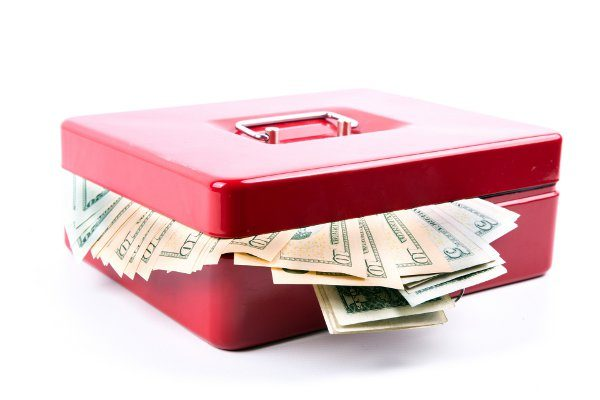 Image of cashbox with money