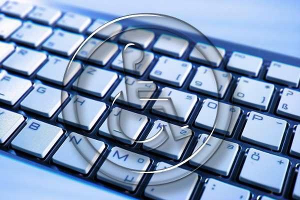 Keyboard overlayed with wheelchair handicap symbol